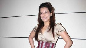 Payal Rohatgi Smiling Modeling Pose At Indian Martial Arts Event